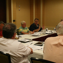 PURE General Manager Frank Dotson (center) makes a point during the second quarter 2012 meeting of the PURE Oil Jobbers Cooperative.